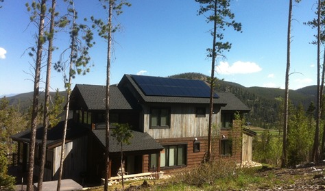 Wooden home with solar power panel