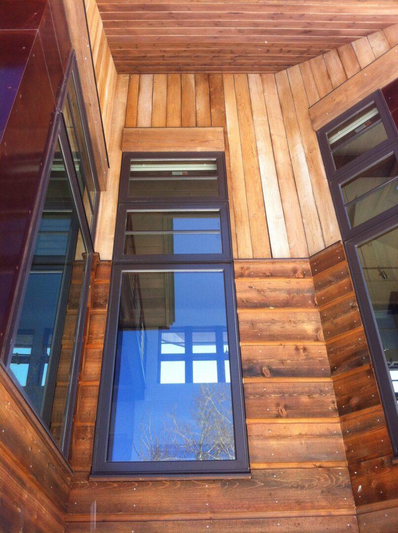Windows on wooden wall
